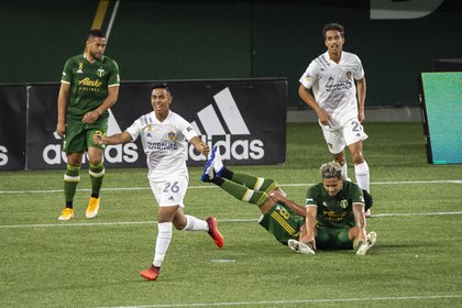 Evrain celebrates a goal with the galaxy team.  Credits: Troy Wayrynen-USA TODAY Sports