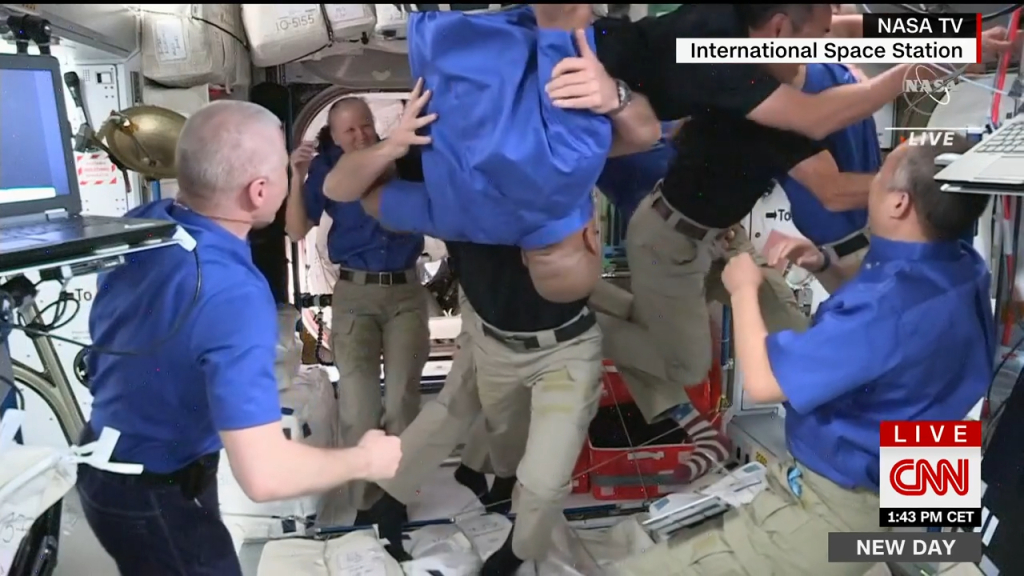 The passionate hugs of astronauts upon their arrival on the International Space Station
