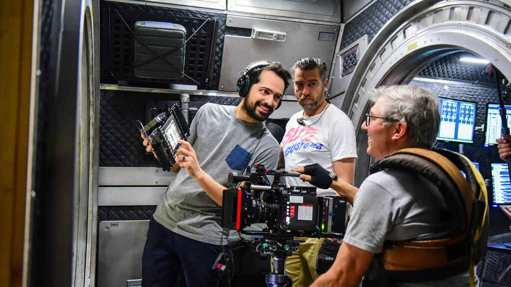 On the left is director Joe Pina while filming.