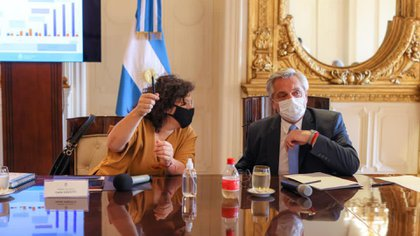 Alberto Fernandez with Carla Vizotti (Chair)