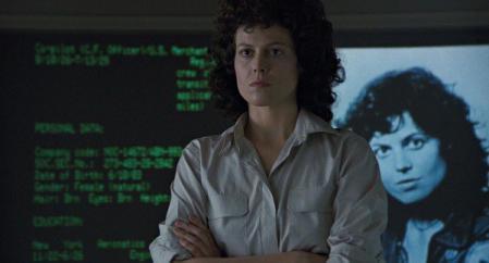Sigourney Weaver, as Ripley, accepts Welland-Yutani's advice in a still from a movie