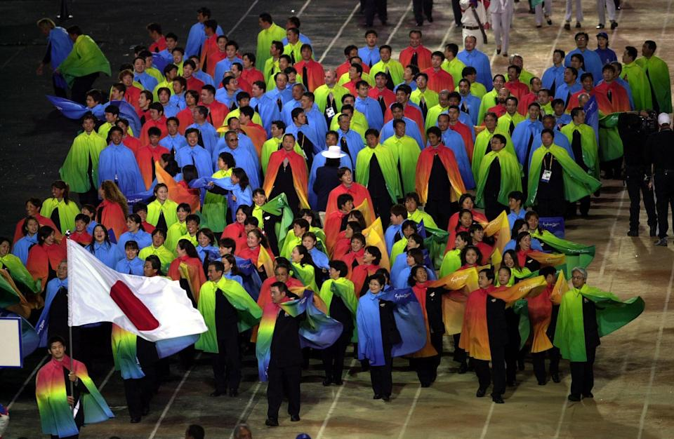 Caption: The colorful coats worn by the Japanese   & # x00200b;  stole the show & # xe1;  Donkey at the 2000 Games Opening Ceremony (Ross Kinnaird/ALLSPORT/Getty Images)
