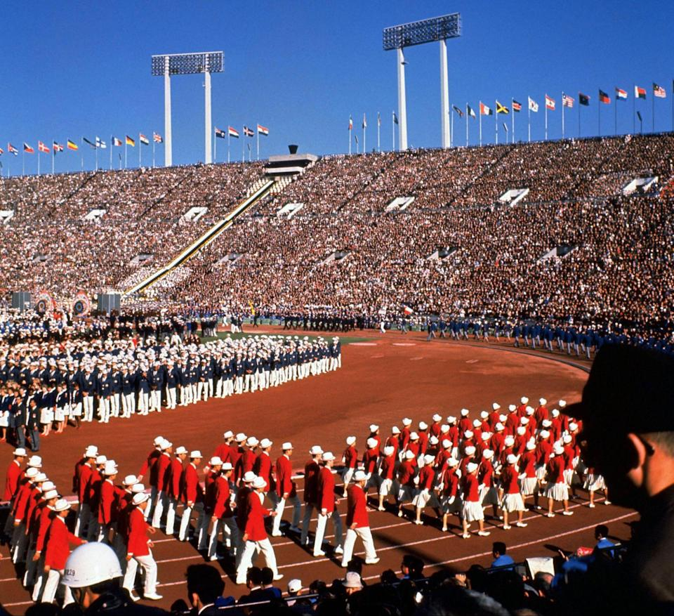 The Japanese delegation at the opening of the 1964 Olympics at home (STR/AFP via Getty Images)