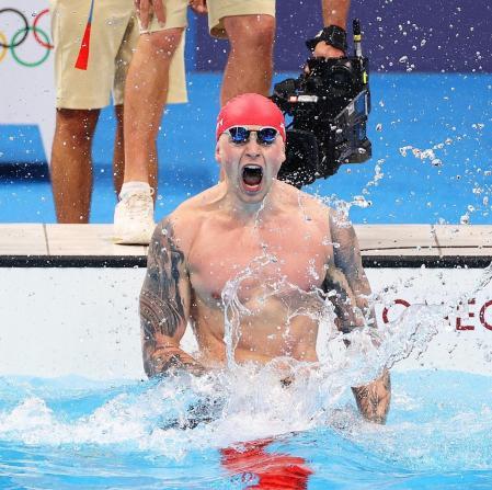 Adam Peaty celebrates his Olympic gold