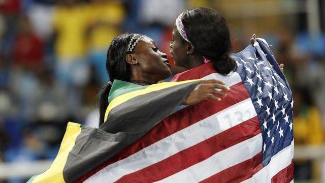 Gold medalist from Jamaica Elaine Thompson hugs American silver medalist Tori Bowie after the 2016 Rio Olympics in the women's 100m final.