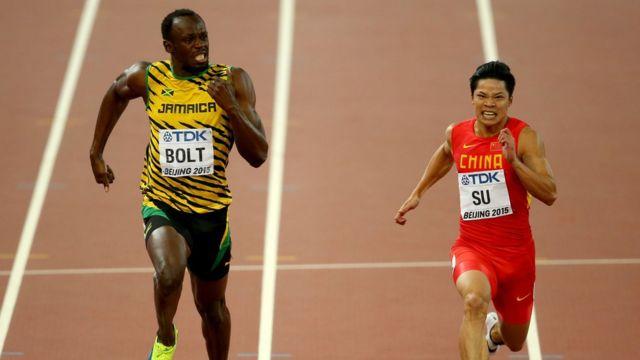 Bingtian Su racing alongside Usain Bolt at the 2015 World Championships.