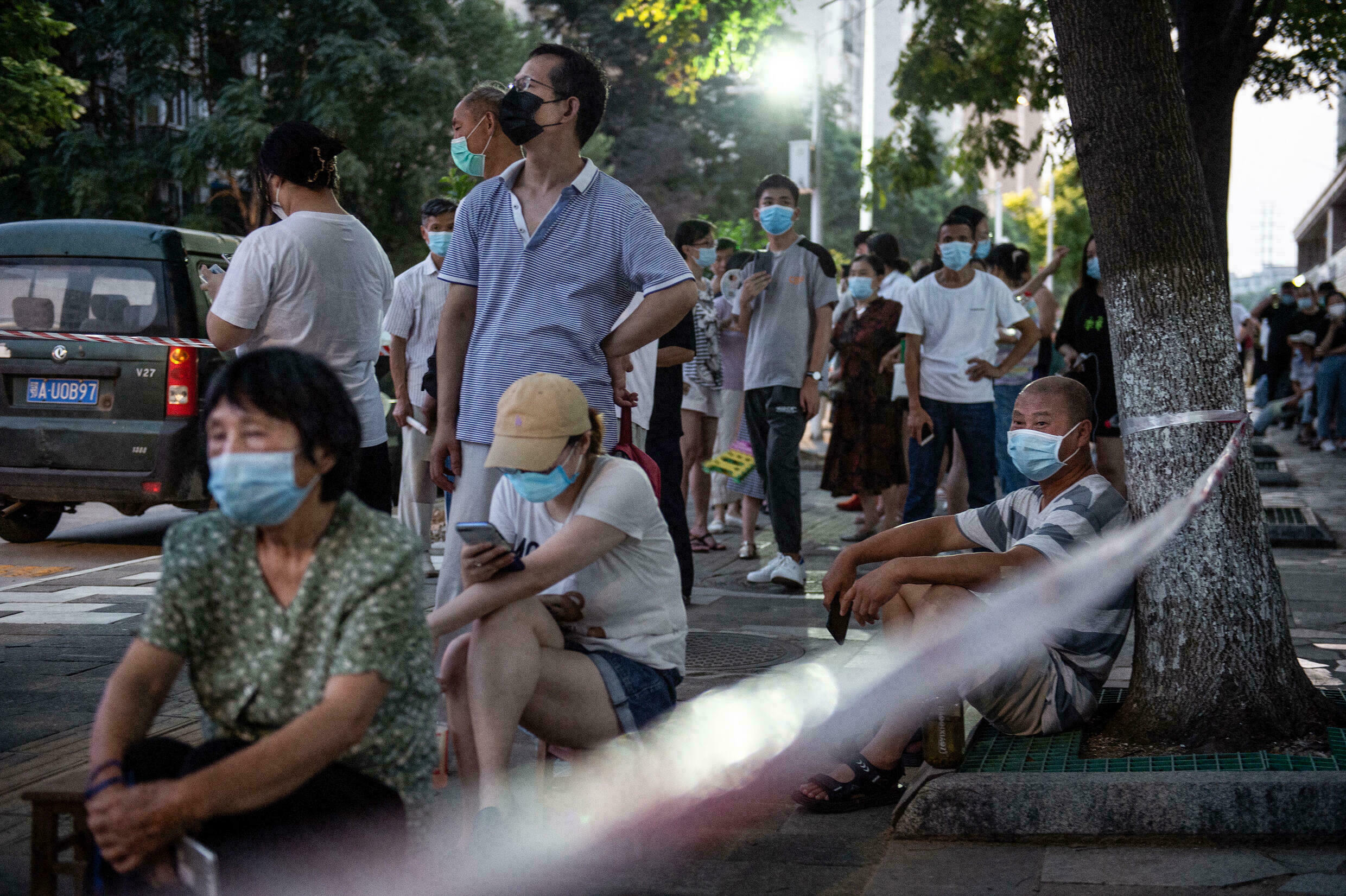 Residents of Wuhan, China, line up for PCR tests for the coronavirus, on August 3, 2021