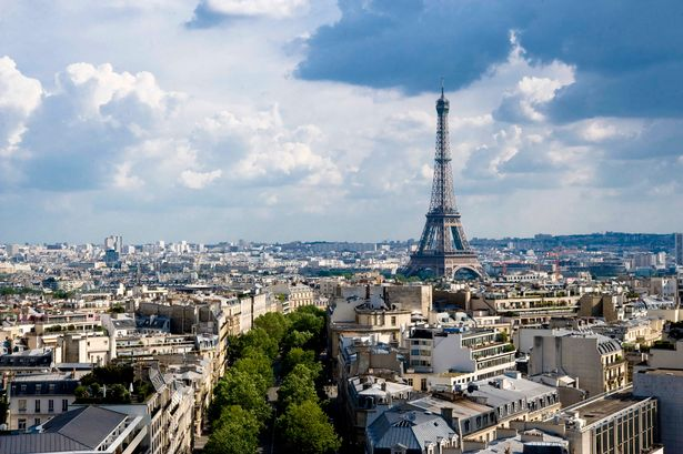 Paris skyline with the Eiffel Tower and rooftops