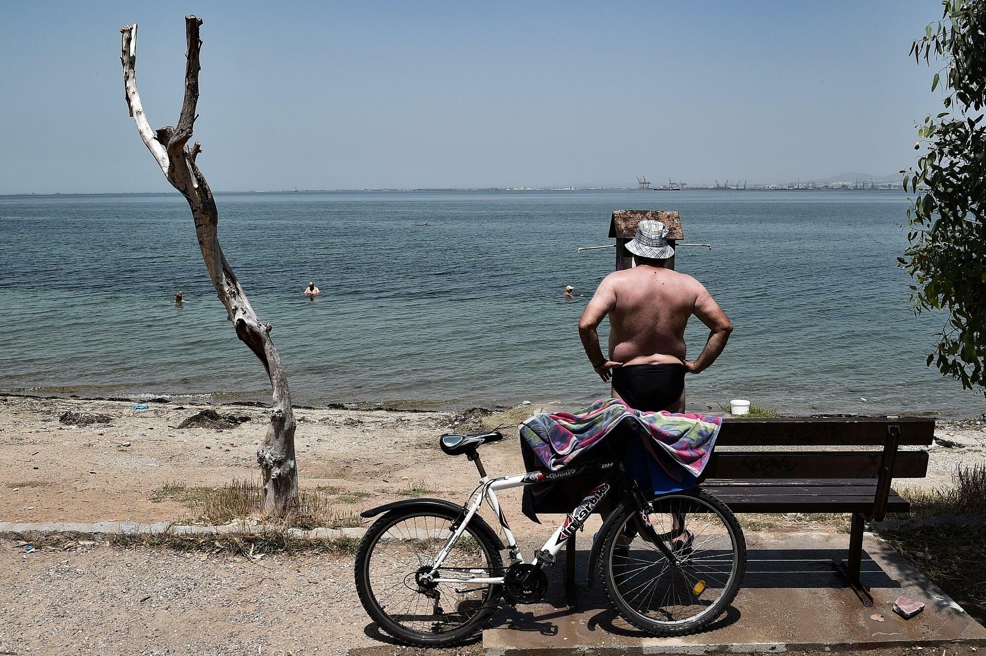 A man near a beach in Thessaloniki.