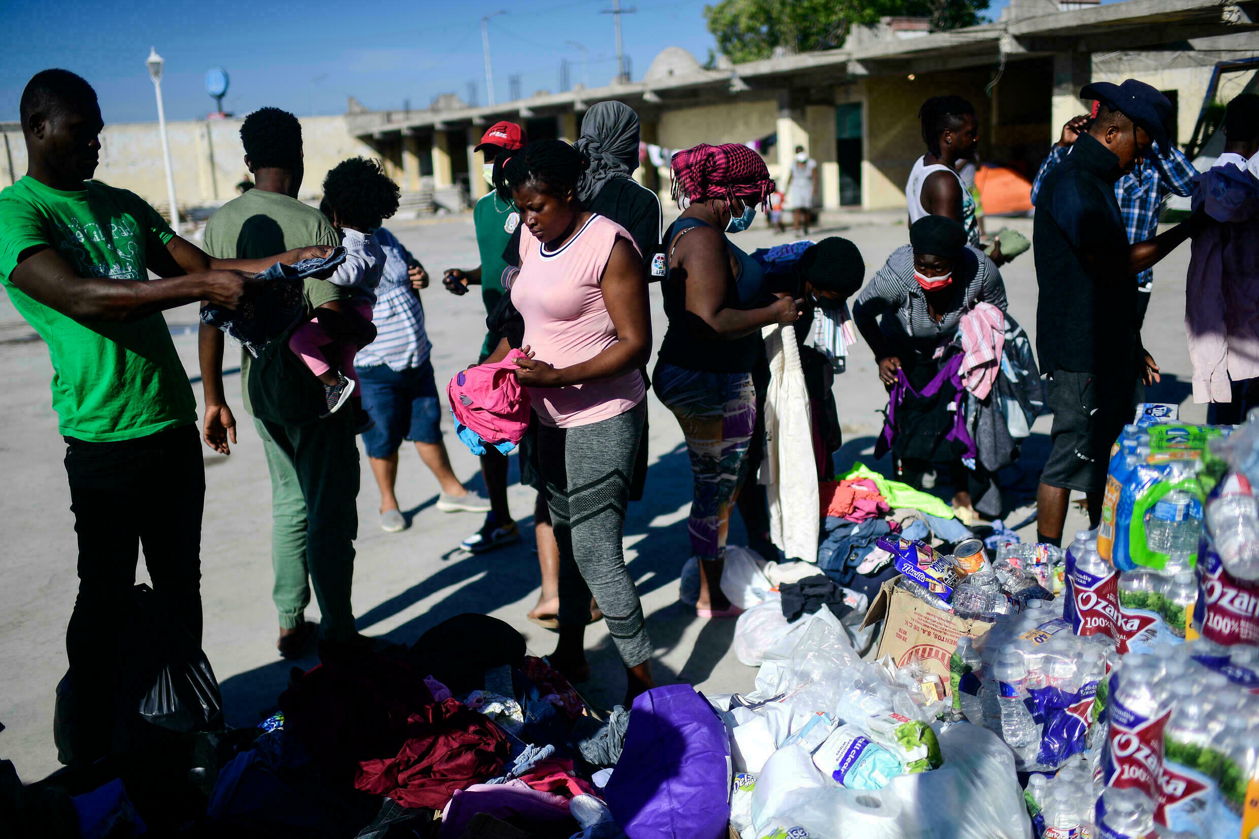 Haitians gather clothes and food at a shelter in Ciudad Acuña, Mexico, on September 25, 2021