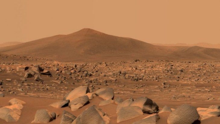 This image shows Santa Cruz, a hill located 2.5 km from the rover.  The whole scene inside Jezero crater on Mars.  The edge of the crater can be seen on the horizon line behind the hill.