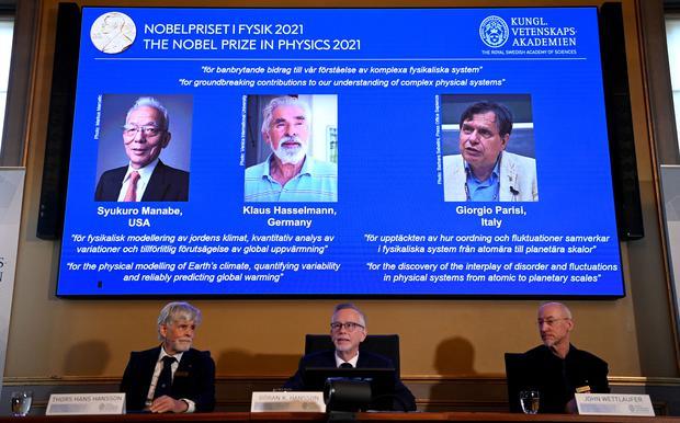 Siokoro Manabe (1st), Klaus Haselmann and Giorgio Baresi share the award.  (Photo: Jonathan Naxstrand/AFP)